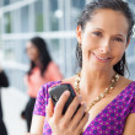Hispanic woman holding cell phone — Stock Photo #25961631