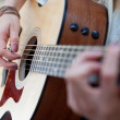Closeup of acoustic guitar playing outdoors — Stock Photo