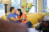 Man and woman sitting on couch. — Stock Photo