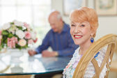 Happy Senior Couple in Diningroom — Stock Photo