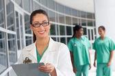 Nurse with clipboard — Stock Photo