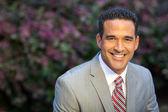 Hispanic man in suit outside — Stock Photo