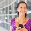 Hispanic woman holding cell phone — Stock Photo