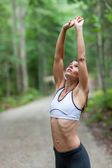 Middle aged woman stretching — Stock Photo