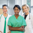 Group of female doctors and nurses — Stock Photo