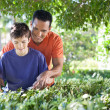 Father and son doing yard work together. — Stockfoto #26005461