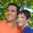 Father and son standing together in yard. — Stock Photo #26009263