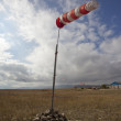 Red and white windsock blows — Stock Photo
