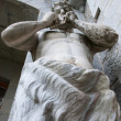 Sculpture of greek god with flute — Stock Photo #31206387