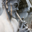 Sculpture of greek god with flute — Stock Photo #31206519