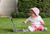 Cute baby with laptop — Stock Photo