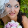 Wedding: young bride in her wedding day — Stock Photo