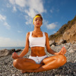 Young woman in lotus pose meditating — Stock Photo