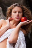Young beautiful girl with apple — Stock Photo