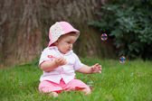 Infant and soapy bubble — Stock Photo