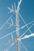 Antenna communications tower in snow — Stock Photo