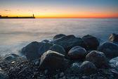 Rocky shore over sunset — Stock Photo