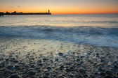 Rocky shore over sunset — Stock Photo