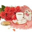 The white cup, orange roses, a pink scarf, cookies, nuts, slices of sugar are isolated on a white background. — Stock Photo