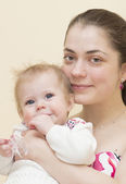 Portrait of young mother with the baby. — Stock Photo