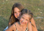 Outdoor portrait of two girls. — Stock Photo