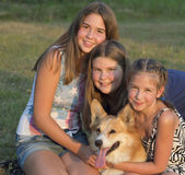Outdoor portrait of group of teenagers with the dog. — Stock Photo