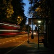 A motion blurred photograph of a red London double decker bus — Stock Photo #27140945