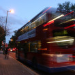 A motion blurred photograph of a red London double decker bus — Stock Photo