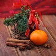 Christmas tree and mandarins. — Stock Photo