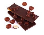 Chocolate with nuts on white. — Stock Photo