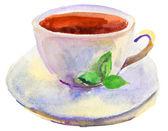 Xícara de chá e uma aquarela de folha verde natural — Fotografia Stock