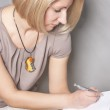 Porttrait of a serious woman making note — Stock Photo #26764327
