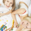 Emotional portrait of young caucasian couple making drawings and — Stock Photo