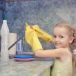 Little girl cleaning things ware with water and gel — Stock Photo