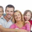 Four happy caucasian family members together — Stock Photo #26768651