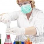 Female laboratory staff dealing with test syringe — Stock Photo #26769393