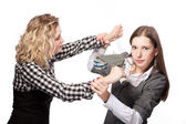 Two caucasian girls playing with tape device trying to glue mouth with scotch tape — Stock Photo