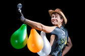 Man in hat with balloons and body-art — Stock Photo