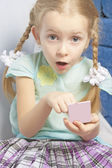 Little fasionable girl applying decorative cosmetics — Stock Photo
