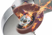 Power circular saw in fire.composite image — Stock Photo