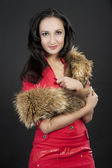 Girl with long tailed fur — Stock Photo