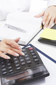 Female hands working with calculator — Stock Photo