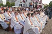 Catholic Bishop praying on Minsk Catholic church opening prior Roman Cardinal Tarcisio Bertone arrival — Stock Photo