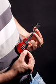 Man with mini guitar — Stock Photo