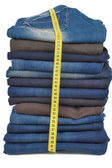 Jeans in stack together with tape-line — Stock Photo