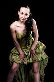 Girl in green dress — Stock Photo