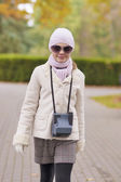 Closeup portrait of young caucasian schooler walking — Stock Photo