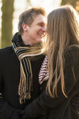Outdoor portrait of couple smiling — Stock Photo