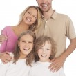 Four happy caucasian family members standing together and smilin — Stock Photo #26770813