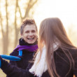 Постер, плакат: Caucasian couple playing with scarf outside